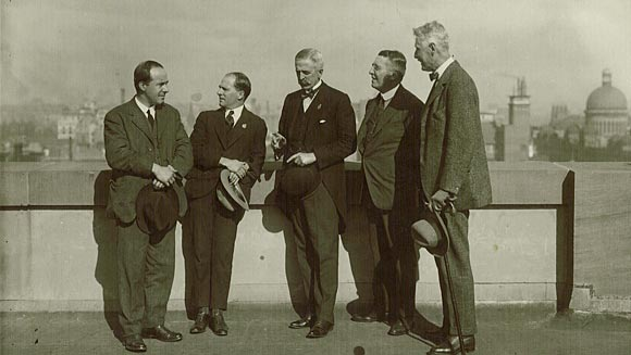 Photograph showing overseas pressmen (accompanying the Prince of Wales) talking with Denison Miller (middle).