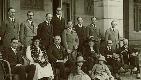 Photograph showing the Prince of Wales (standing in the centre holding his hat) including Sir Walter Davidson, Governor, New South Wales (seated to the left of the Prince of Wales) and the Governor's wife, Dame Margaret Davidson (seated to the right of the Prince of Wales).