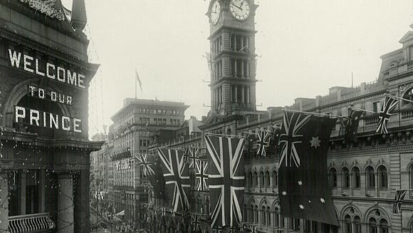 Photograph showing the lower part of Martin Place (looking up towards Pitt Street) decorated for the Prince's visit. The GPO (General Post Office) is in the foreground.