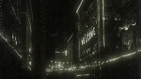 Photograph showing decorations by night on the Head Office building for the Prince of Wales' visit to Australia, June 1920.