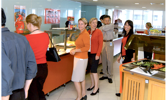 Photograph showing some staff in Cafetaria on Harmony Day