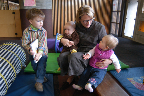 Photograph showing The Reserve Bank's participation in a joint-venture early childcare facility in the Sydney CBD. Children of Reserve Bank staff are shown with one of the parents (Stephanie Weston, Senior Manager, Payments Policy Department).