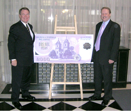 Photograph showing Chris Ogilvy, Chief Executive of Note Printing Australia, and Myles Curtis, Managing Director of Securency Pty Ltd, at the launch of the 2,000 peso polymer note in Santiago, Chile in September 2004.