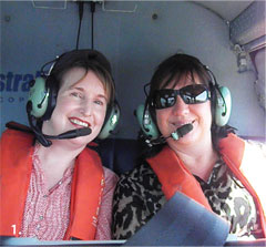 Senior Representative Karen Hooper (left) and Economist Marileze van Zyl of the Queensland State Office, on board a helicopter over Curtis Island