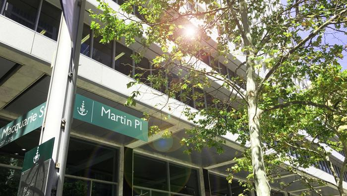 A photograph of a Martin Place street sign in front of the Reserve Bank Head Office