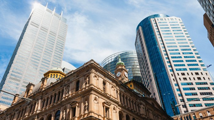 Tow high-rise buildings frame the upper portion of the Sydney's Town Hall