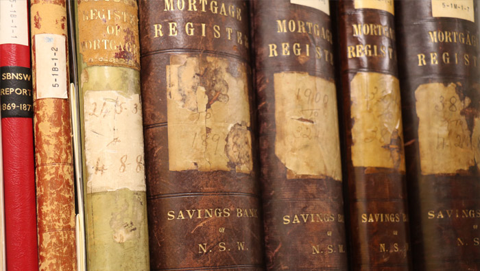 The spines of some old books on a shelf.