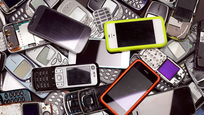 A collection of old and new mobile phones.