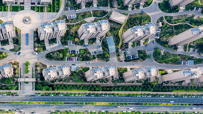 An aerial view of motorways and skyscrapers in a residential area in Beijing, China.